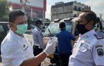 Cegah Corona DISHUB Lampung Selatan Sterilisasi Angkutan Umum Di Jalan Raya Natar